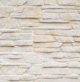 Wall of carved limestone bricks — Stock Photo