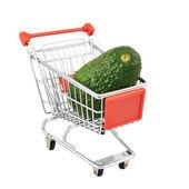 Avocado in shipping cart — Stock Photo