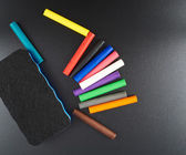 Board with chalks — Foto Stock