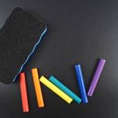 Black board with chalks — Stock Photo