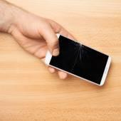 Hands holding phone — Stock Photo