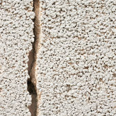 Cracked cement wall fragment — Stock Photo