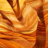 Fragment of orange fabric — Stock Photo