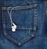 Headphones in a back pocket of a jeans — Stock Photo