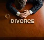 Word Divorce and devastated man composition — Stock Photo