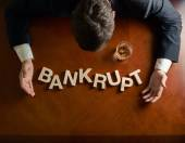 Word Bankrupt and devastated man composition — Stock Photo