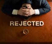 Word Rejected and devastated man composition — Stock Photo