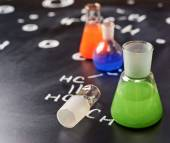 Chemistry tubes filled with colorful liquids — Stock Photo