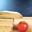 Apple, books and blackboard composition — Stock Photo #57456713