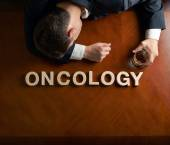 Word Oncology and devastated man composition — Stock Photo