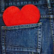Red heart in a back pocket of a jeans — Stock Photo #57848801