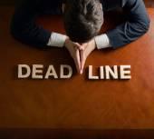 Devastated man and word Deadline — Foto de Stock