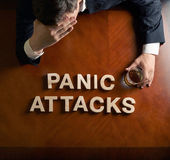Phrase Panic Attacks and devastated man composition — Stock Photo