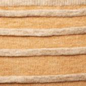 Knitted beige sweater fragment — Stock Photo