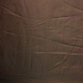 Striped creased brown silk material — Stock Photo