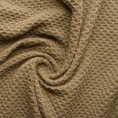 Knitted beige cloth material fragment — Stock Photo