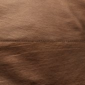 Brown leather material fragment — Stock Photo