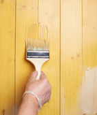 Process of painting wooden boards — Stock Photo