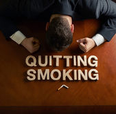 Phrase Quitting Smoking and devastated man composition — Stock Photo