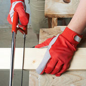 Sawing wooden board — Stock Photo