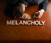 Word Melancholy and man — Stock Photo