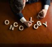 Word Oncology and man — Stock Photo