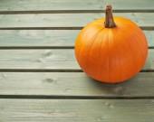 Pumpkin on  wooden boards — Stock Photo