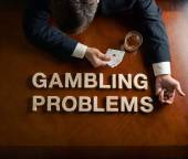 Phrase Gambling Problems and devastated man composition — Stock Photo