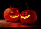 Two glowing jack o lantern pumpkins — Stock Photo