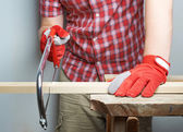 Sawing wooden board composition — Stock Photo