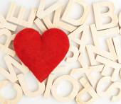 Heart over the wooden letters — Stockfoto