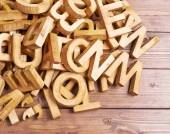 Pile of wooden letters over the wooden surface — Stock Photo