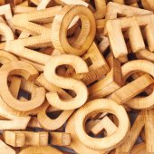 Surface covered with multiple wooden letters — Foto de Stock