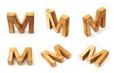 Six block wooden letters M — Zdjęcie stockowe
