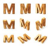 Nine block wooden letters M — Stock Photo