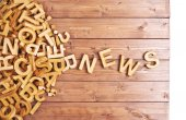 Word news made with wooden letters — Stock Photo