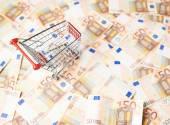 Shopping cart over the bank note bills — Fotografia Stock