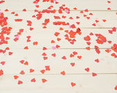 Surface covered with heart shaped confetti — Стоковое фото