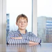 Childen sitting still at the wooden desk — Stock Photo