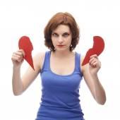 Kvinna med två halvor av rött hjärta — Stockfoto