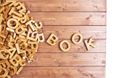 Word book made with wooden letters — Stock Photo