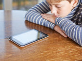 Boy  looking at the tablet pad device — Stock Photo