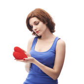 Woman holding the red heart — Stock Photo