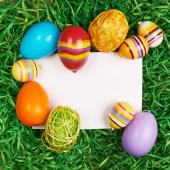 Easter eggs around white card — Stock Photo