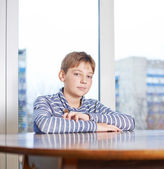 Childen sitting still at the wooden desk — Stock Photo