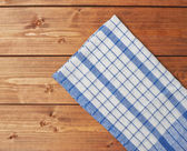 Tablecloth or towel over the wooden table — Photo