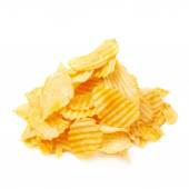 Yellow ribbed potato chips — Stock Photo