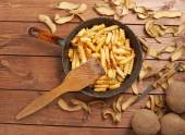 Cooking fried french potatoes — Stock Photo