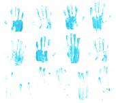 Palm prints and finger smears of paint — Stock Photo