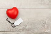 Red heart with old key — Stock Photo